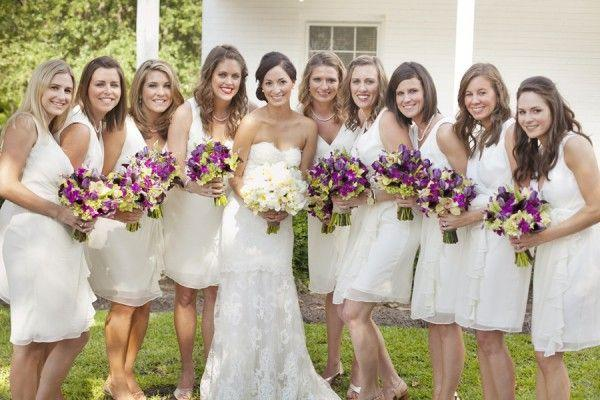bridesmaids in white dresses with brides